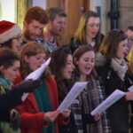A group of people sing carols at a festival in Bath, U.K.