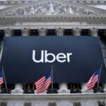 A photo of the Uber sign hanging on the New York Stock Exchange for its tech investing IPO.