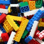 A photo showing a pile of Lego building blocks in many colors and sizes.