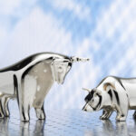 A conceptual image showing figurines of a bull and a bear.