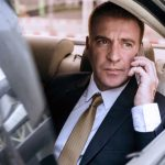 Businessman on cellphone in car
