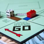 """A photo of the """"Go"""" space on a Monopoly board instructing players to collect $200 as they pass."""