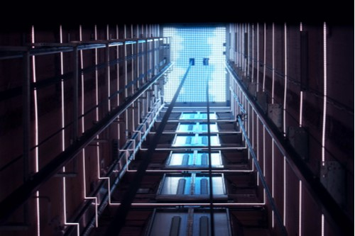 A photo showing an empty elevator shaft in a high-rise building.