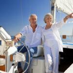 A senior couple enjoys retirement on their boat