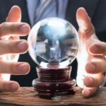 A photo showing a businessman using a crystal ball.