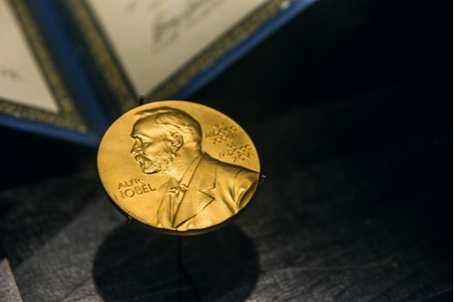 A photo showing a Nobel Prize medal on display.