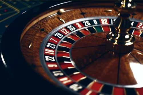 A photo showing a spinning roulette wheel in a casino.
