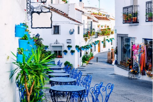 A photo showing buildings along a street in Mijas, Andalucia, in southern Spain.