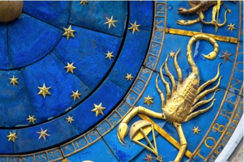 A photo showing the detail on an ancient astrological clock with zodiac signs.
