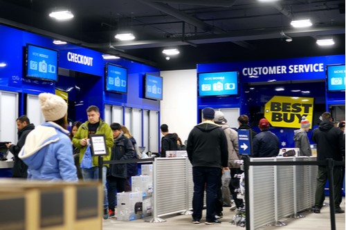 A photo showing a long checkout line at a Best Buy store during the holiday shopping season.