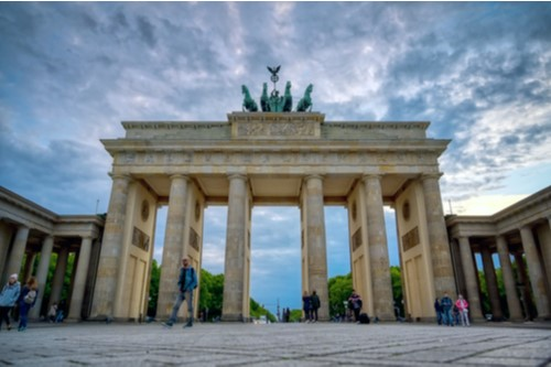 A photo of the Brandenburg Gate in Berlin at sunset.