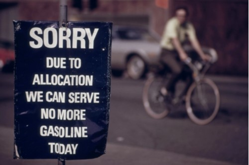 "A photo showing a gas station sign during the 1970s energy crisis reading ""Sorry, due to allocation we can serve no more gasoline today."""