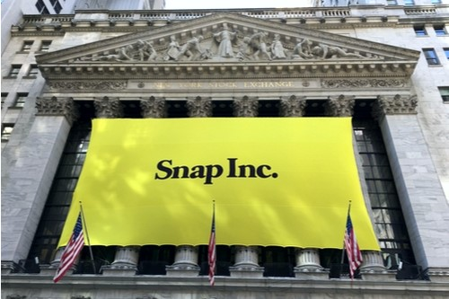 A photo showing a large yellow Snap Inc. sign on the New York Stock Exchange building marking the day of the startup's IPO.