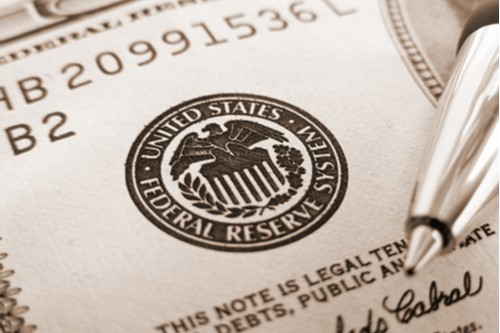 The seal of the Federal Reserve as shown on a $100 bill.