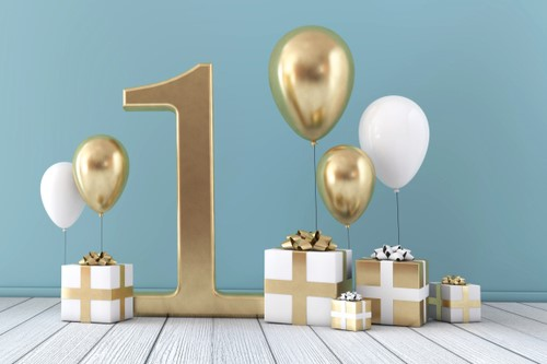 An image showing a large gold No. 1 surrounded by balloons and gift boxes.