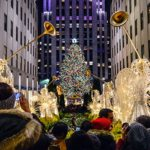 A crowd of tourists visits Rockefeller Center in New York City to view the Christmas tree and holiday decorations.