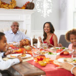 A photo of a family gathered around a table for Thanksgiving dinner