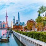 A photo showing the skyline and waterfront of Shanghai, China, at dusk.
