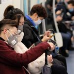 A photo showing subway passengers in Wuhan, China, wearing surgical masks to protect against the novel coronavirus.