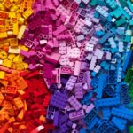 A photo showing many different colors of Lego building blocks.