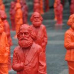 A photo showing a group of sculptures of Karl Marx by artist Ottmar Hörl in Trier, Germany.