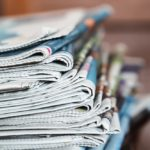 A photo of a large stack of newspapers.