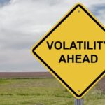 "A photo showing a road warning sign stating ""Volatility Ahead."""