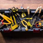An overhead photo showing a well-stocked toolbox including many different tools.