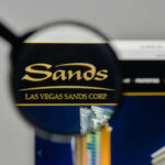 A photo showing a magnifying glass over the Las Vegas Sands logo.