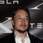 A photo of Elon Musk at a Tesla event.