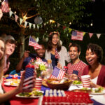 A photo of friends enjoying a backyard barbecue to celebrate the Fourth of July.