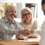 A senior couple speaks with their broker