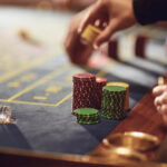 A person makes a bet at a roulette table