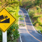 A traffic sign shows a steep incline ahead