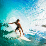 A surfer rides an ocean wave