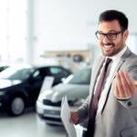 A salesman at a car dealership