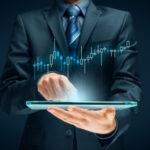 A trader studies a stock market chart