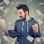 A man celebrates his profitable online trades