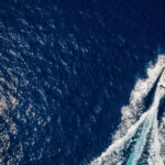 A speedboat travels over the ocean