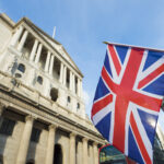 A Union Jack flag flies in front of the Bank of England in London