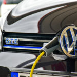 A Volkswagen Golf is charged at a charging station