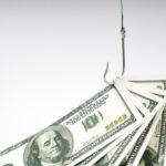 Hundred-dollar bills caught on a fish hook