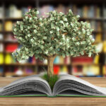 A money tree grows out of a book
