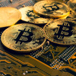 An image of several golden Bitcoin on top of a motherboard.
