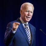 President Joe Biden speaks into a microphone