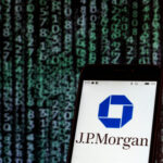 An image of a phone showing the JPMorgan Chase logo in front of a background of code.