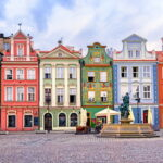 A photo of colorful Renaissance buildings in a market square in Poland.