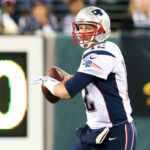 A photo showing Tom Brady throwing a pass as quarterback for the New England Patriots.