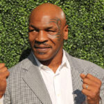 Former boxing champion Mike Tyson poses in his signature boxing stance.