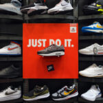 A photo showing a large display of Nike shoes in a store.